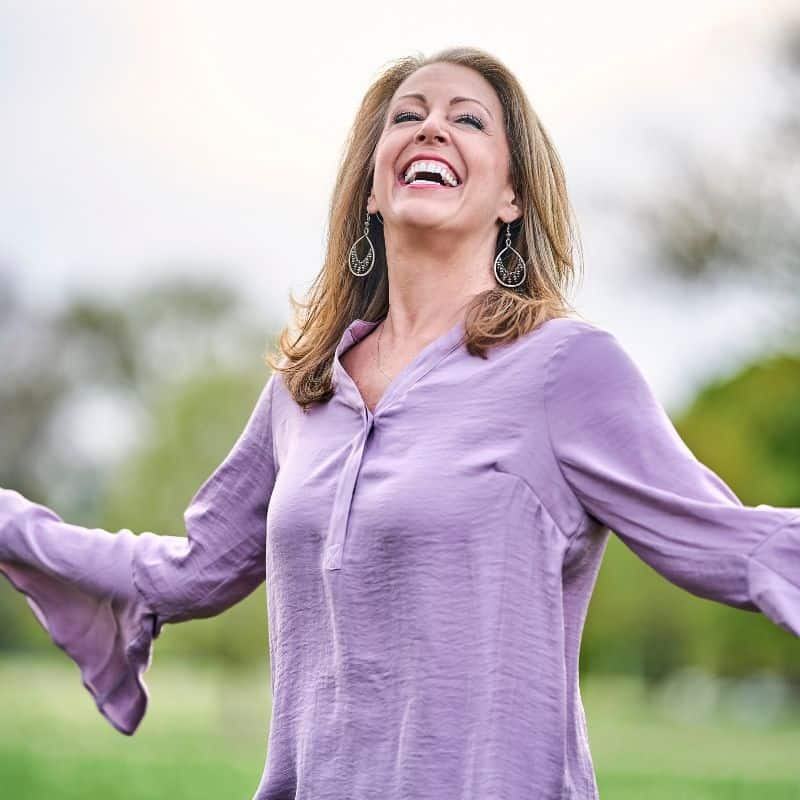 Kendra Von Esh in a purple shirt in the garden